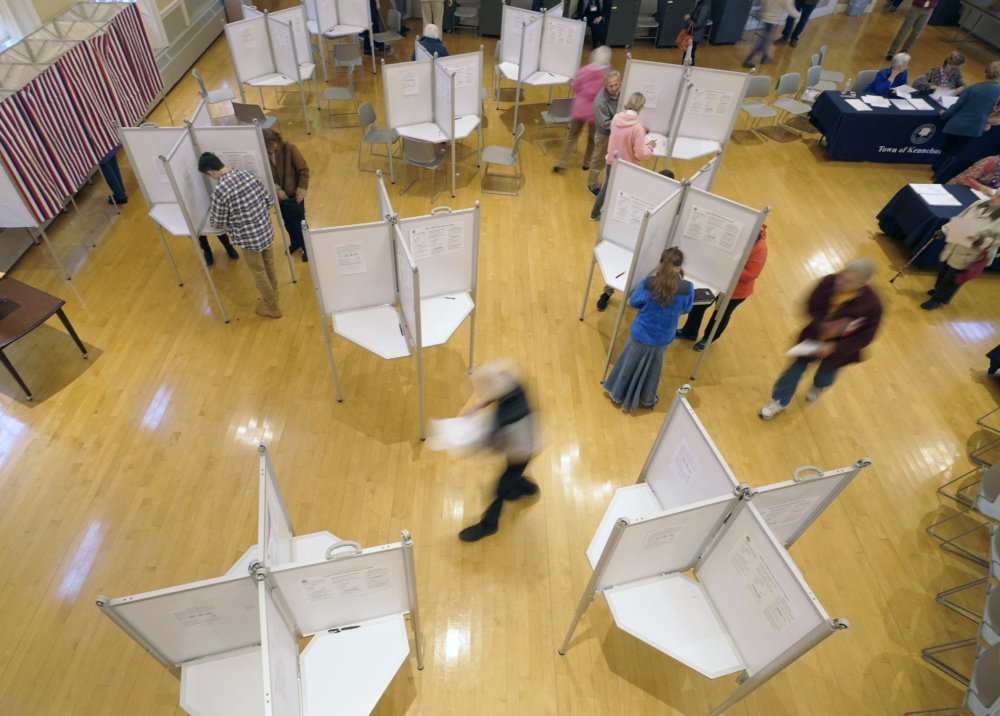 "Kennebunk residents vote at Kennebunk Town Hall on Tuesday afternoon. Secretary of State Matt Dunlap spent the day visiting polling places. He agreed that turnout seemed to be higher than expected for an off year, with no statewide or national candidates on the ballot. ""Things have been smooth and quiet so far,"" he said."