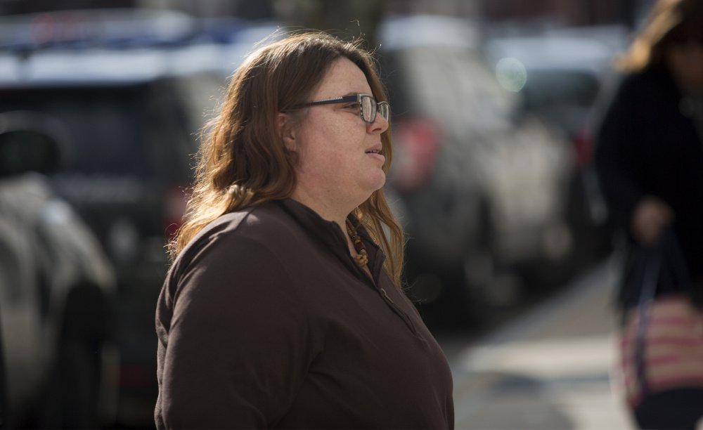 Hope Cady walks to the Cumberland County Courthouse in Portland on Tuesday prior to taking the stand as a witness in the post-conviction review of Anthony Sanborn, who spent 27 years in prison for the slaying of Jessica L. Briggs.