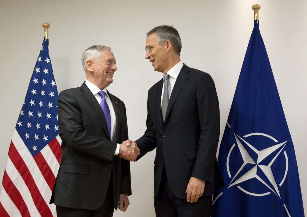 U.S. Secretary for Defense Jim Mattis, left, shakes hands with NATO Secretary General Jens Stoltenberg at NATO headquarters in Brussels on Wednesday