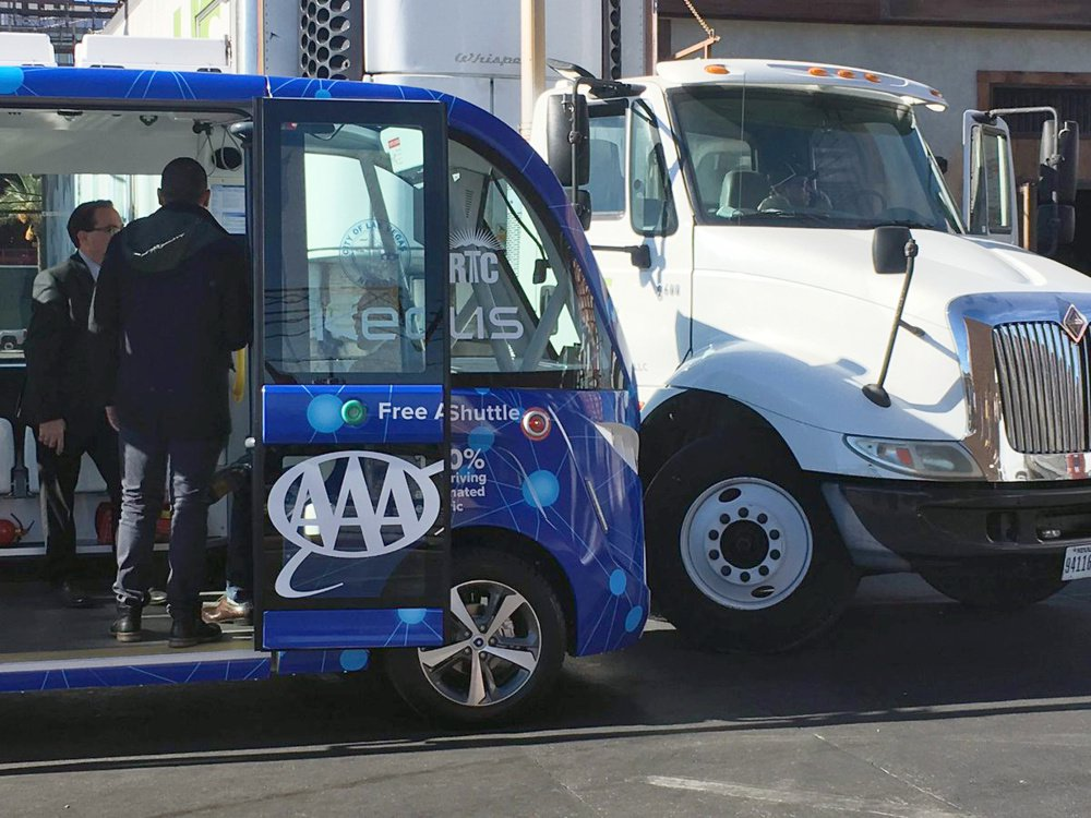 A driverless shuttle bus was hit by a big rig in Las Vegas on Wednesday less than two hours after the automated ride service was launched to great fanfare.