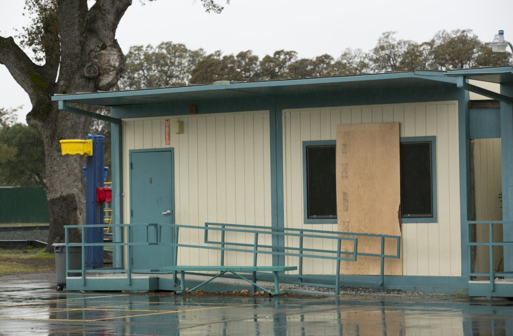 Plywood covers a window at the Rancho Tehama Elementary School on Wednesday, a day after Kevin Janson Neal's shooting rampage at Rancho Tehama Reserve, Calif.
