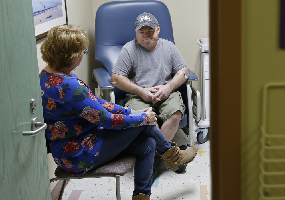 Brian Madeux, who has Hunter syndrome, waits with Marcie Humphrey, at the Oakland, Calif., hospital where an experimental gene therapy took place Monday to combat his disease.