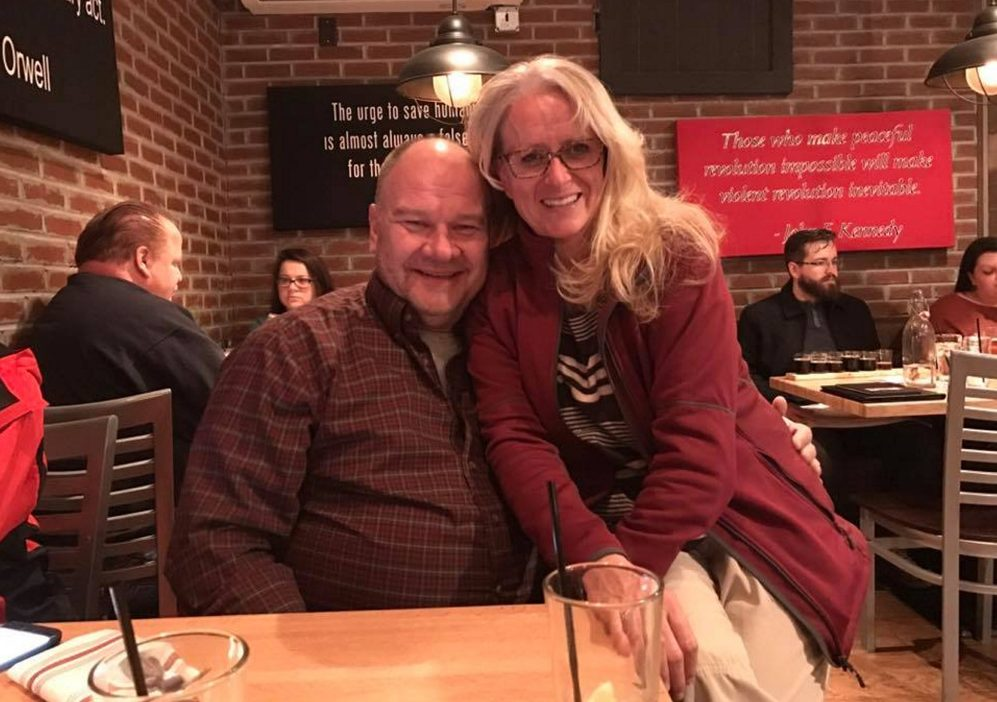 "Mike Burns, shown with his ex-wife Kimberly Houle, was known as a devoted father and Boy Scout troop leader. He ""was a lover, not a fighter,"" said Dean Rondeau, a friend who met Burns in college."
