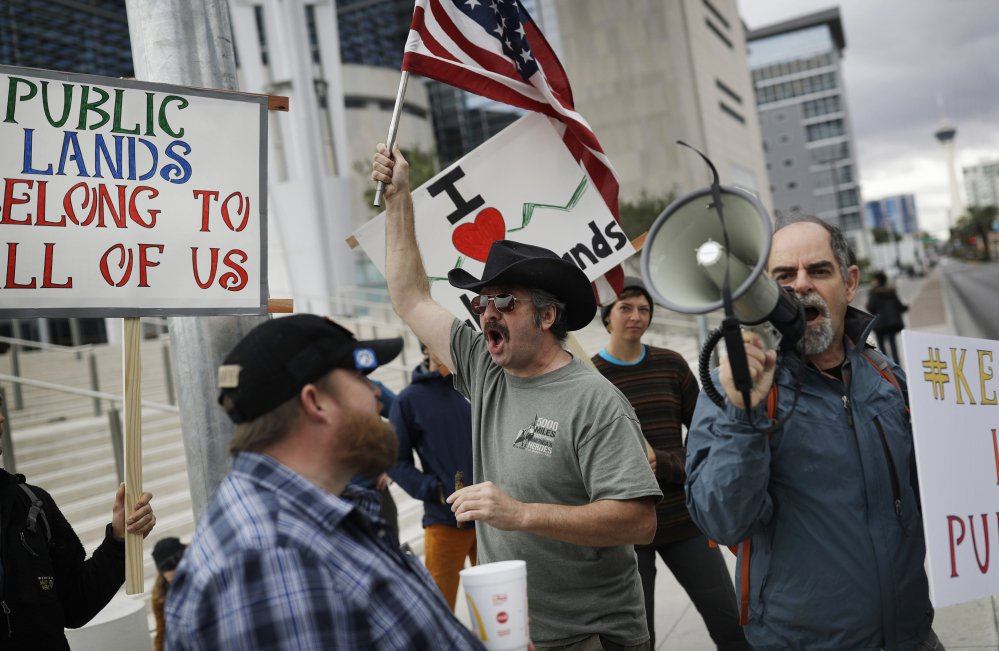 Protesters gather in Las Vegas last winter to show support for Cliven Bundy and his sons. Associated Press