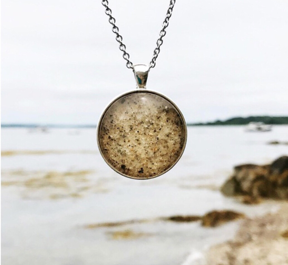 A Kate Clark pendant containing sand from the beach at Cushing Point on Long Island.