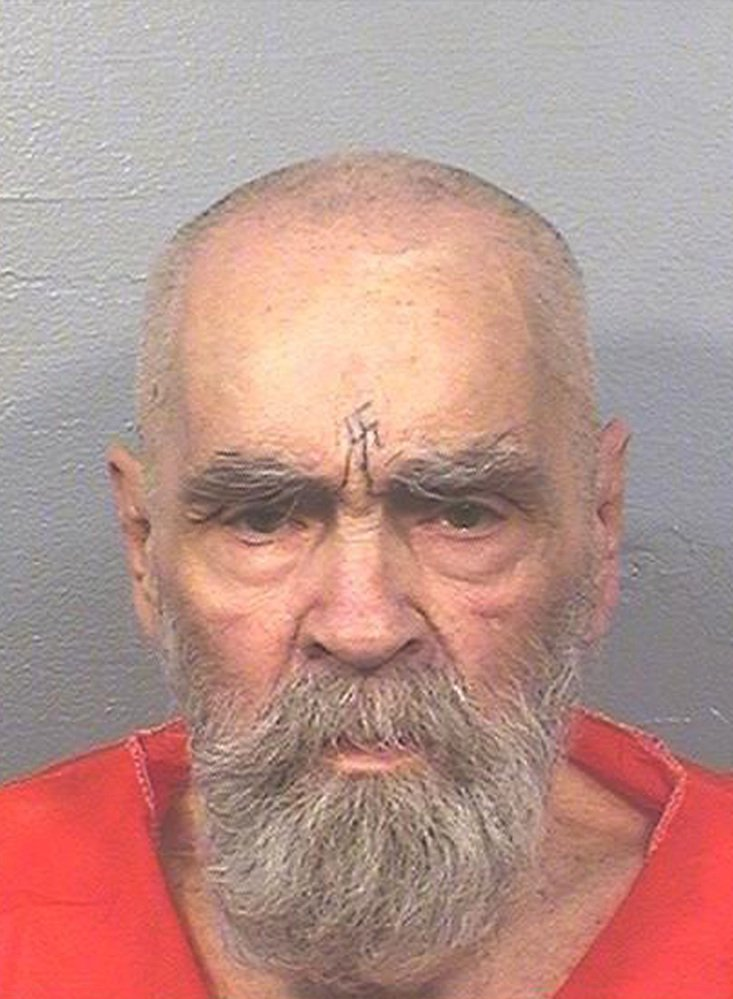 Charles Manson, photographed Aug. 14 by the California Department of Corrections and Rehabilitation, was ill but still alive Thursday, said a spokeswoman for the corrections department.