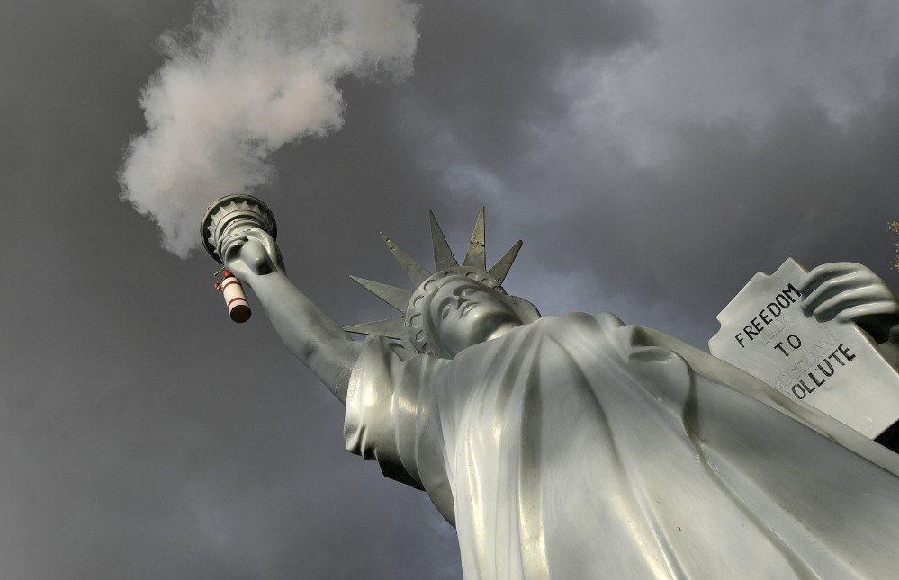 A replica of the Statue of Liberty by Danish artist Jens Galschiot emits smoke in a park outside the 23rd U.N. Conference of the Parties climate talks in Bonn, Germany.