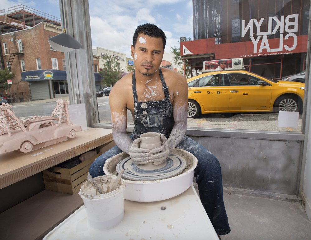 Luis Marte poses for the NYC Taxi Drivers Calendar in New York. Sales of the tongue-in-cheek calendar featuring 12 New York City cabbies benefit a social-service organization.