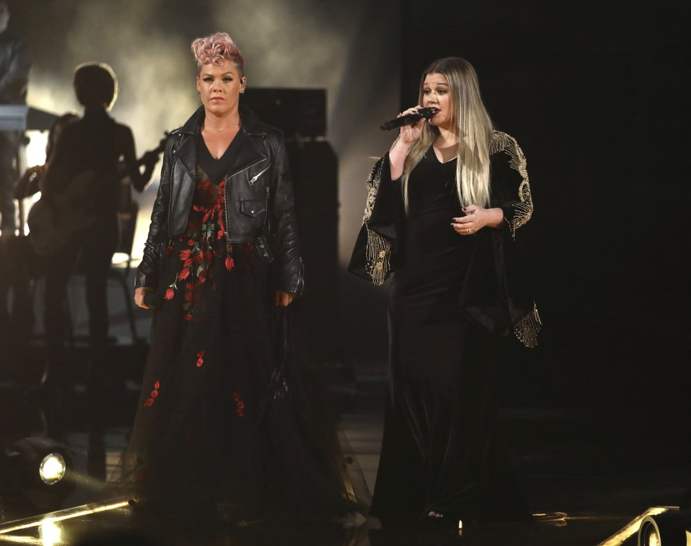 "Pink, left, and Kelly Clarkson perform ""Everybody Hurts"" at the American Music Awards. (Photo by Matt Sayles/Invision/AP)"