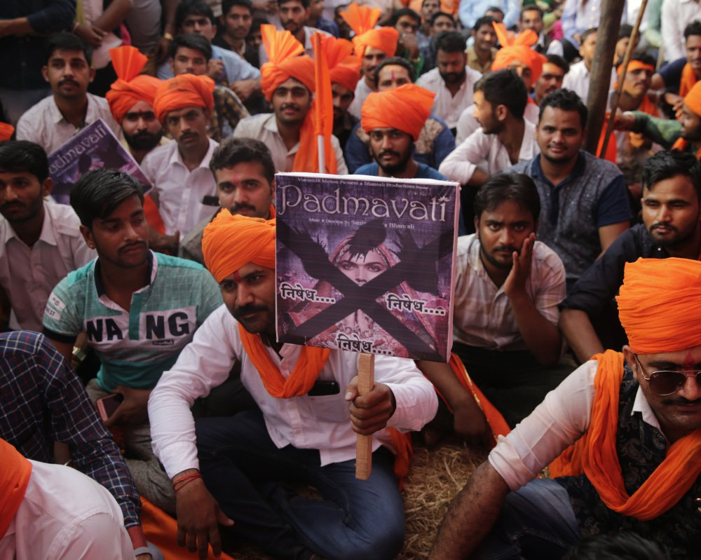 "Members of India's Rajput community hold placards as they protest on Monday against the release of Bollywood film ""Padmavati"" in Mumbai, India. (AP Photo/Rafiq Maqbool)"