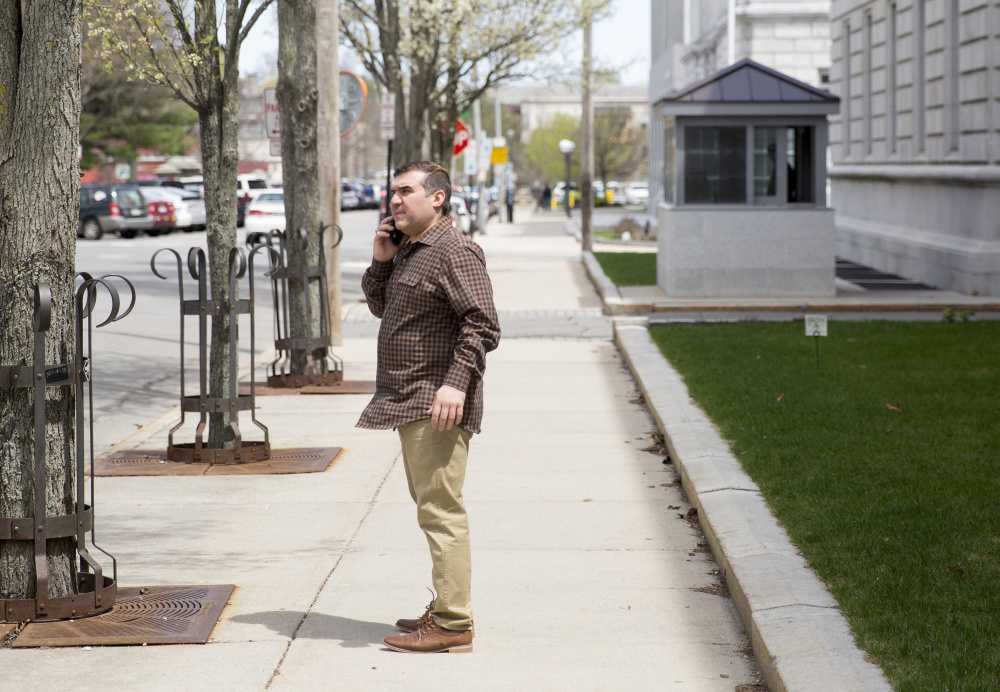 Ratib Daham, 40, talks on the phone after walking out of the federal courthouse in Portland on May 4. He and his brother, Abdulkareem Daham, 21, were charged with conspiring to defraud the United States through their operation of Ahram Halal Market on Forest Avenue.