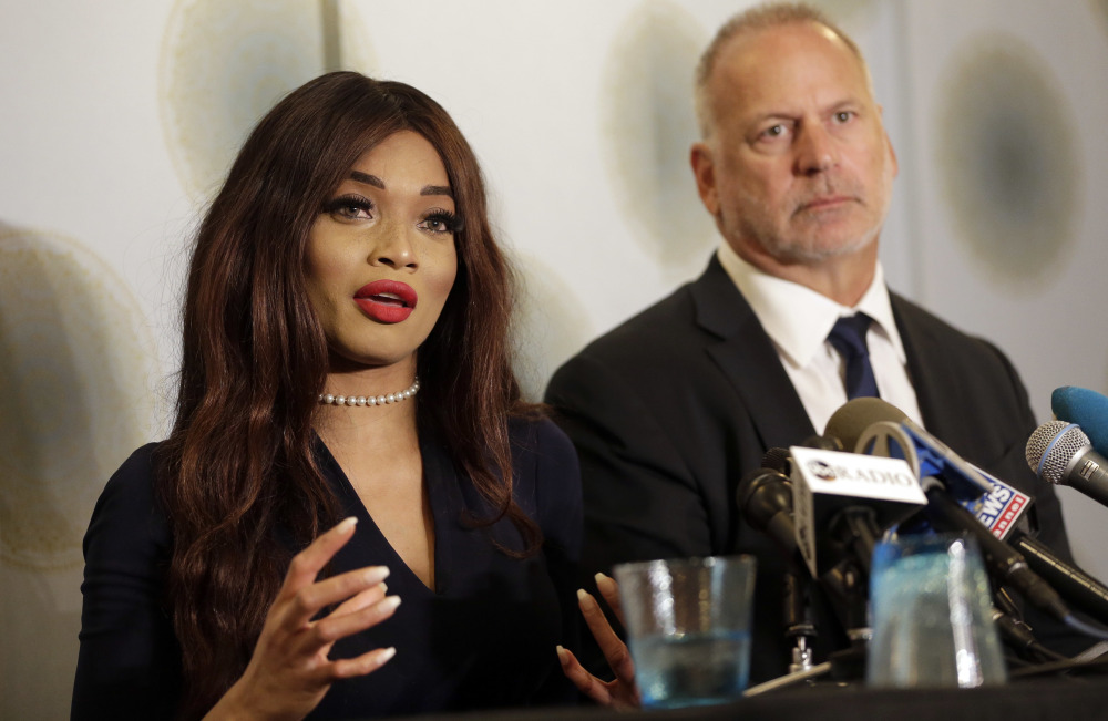 Kadian Noble at a news conference with her attorney Jeff Herman in New York, Tuesday. Noble filed a suit Monday against Harvey Weinstein.