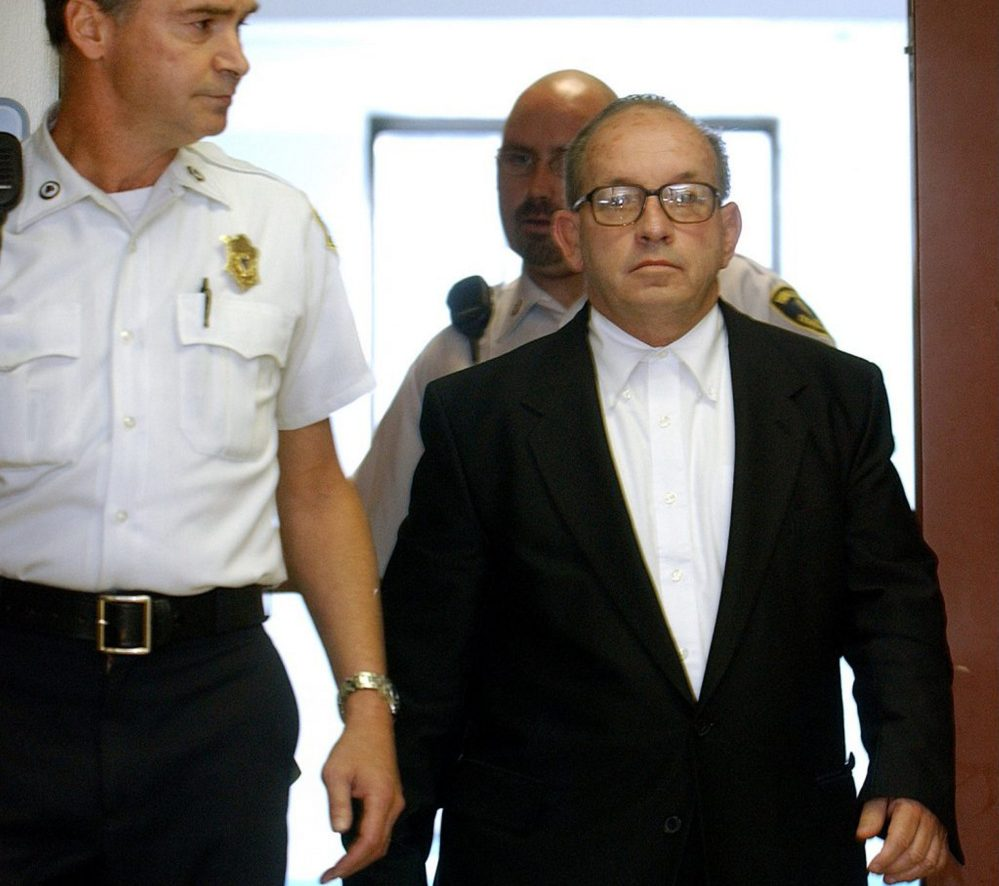Pictured at an arraignment in Boston on Sept. 19, 2002, James F. Talbot was extradited this week from Missouri to Maine to face sexual abuse charges in a 1997-98 Freeport case.