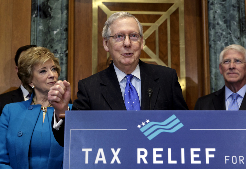 Senate Majority Leader Mitch McConnell, flanked by Small Business Administration chief Linda McMahon, left, and Sen. Roger Wicker, R-Miss., speaks to small-business owners Thursday on Capitol Hill as Republicans work to pass their sweeping tax bill.