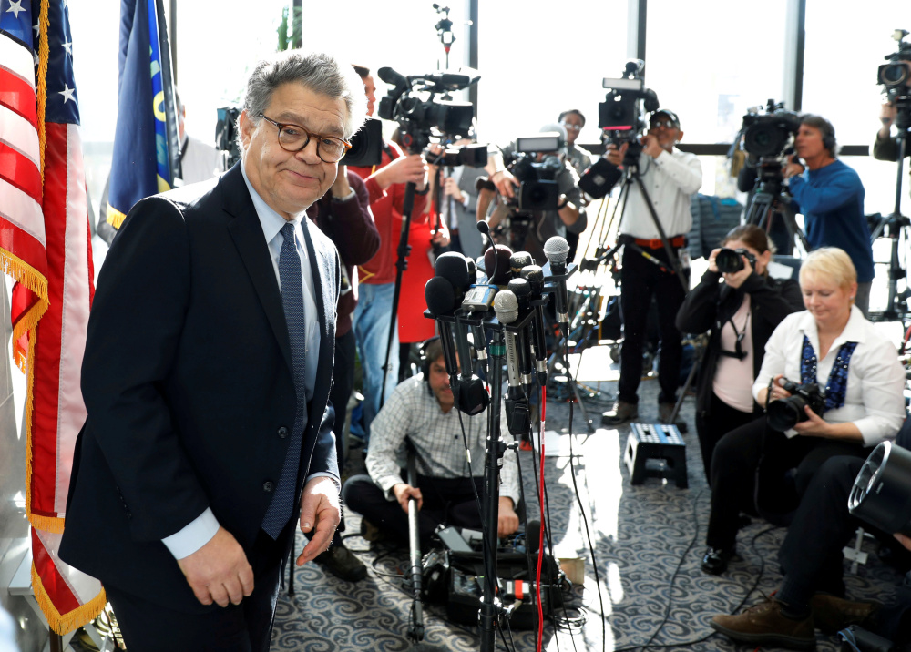 U.S. Sen. Al Franken ends a news conference on Capitol Hill on Monday. None of his fellow Democratic senators have called for him to resign, but his position appears shaky.