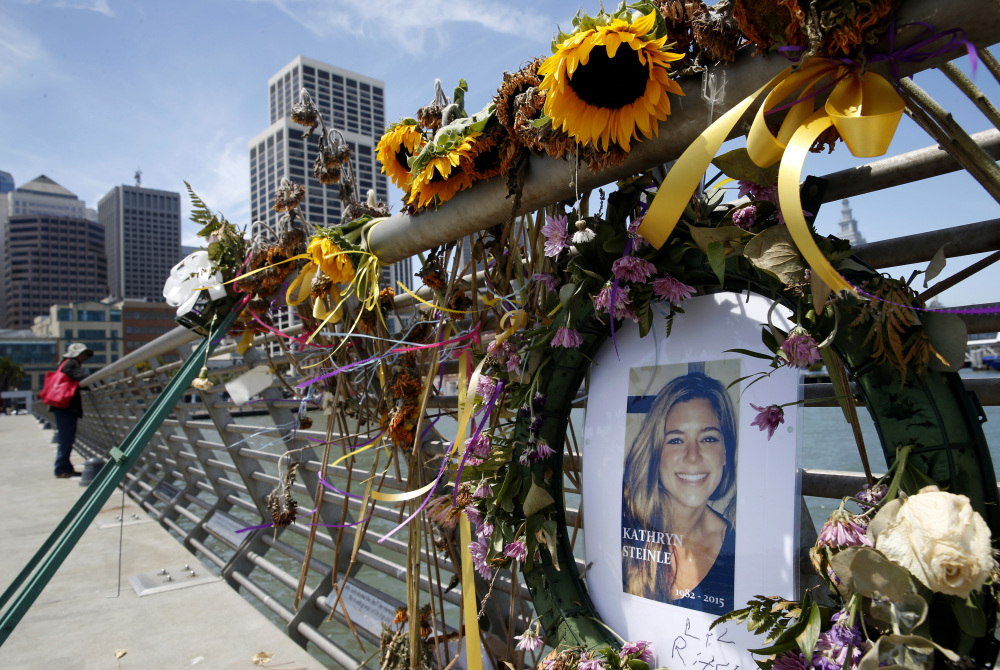 Flowers and a portrait of Kate Steinle formed a memorial on Pier 14 in San Francisco after her death in July of 2015.