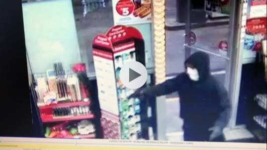 A man wearing a white mask robbed the South Portland Circle K at gunpoint Sunday.