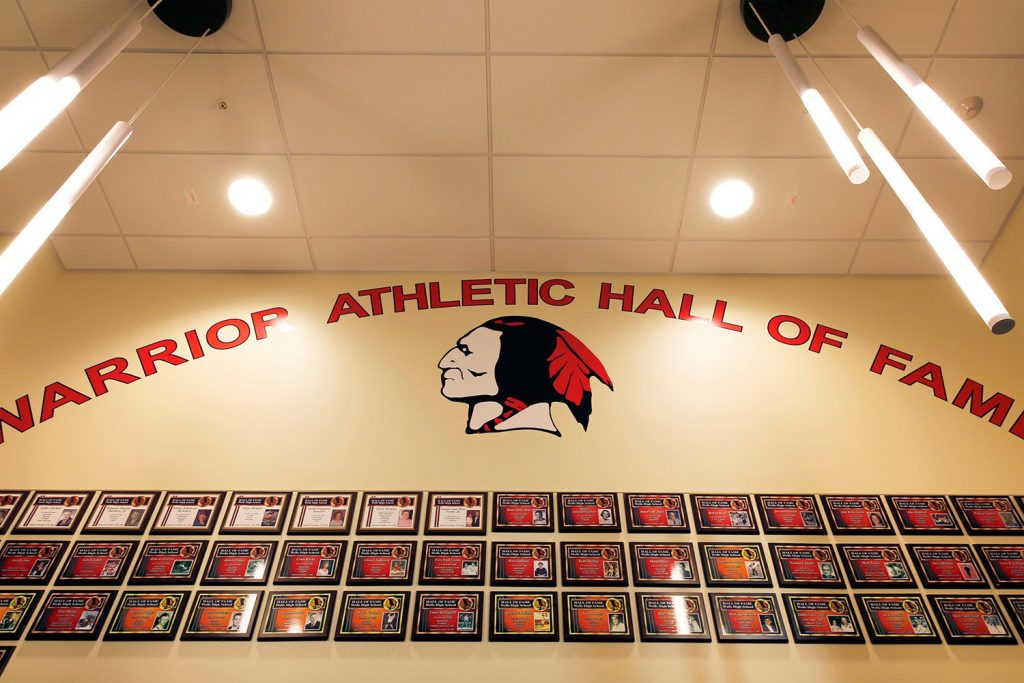 The foyer to Wells High School's athletic center prominently displays the school's mascot.