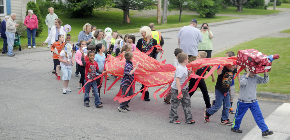 T.C. Hamlin School students parade through Randolph in 2016 to celebrate the number of books they read during the school year. Enrollment at the Randolph elementary school has declined to 44 students, prompting the school district to consider whether to keep it open or close it.