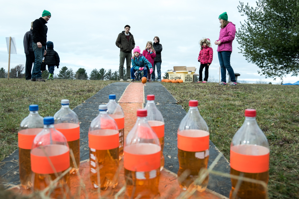 Children try their hands at pumpkin bowling at the 2016 Fall Festival at the Quarry Road Recreation Area in Waterville.