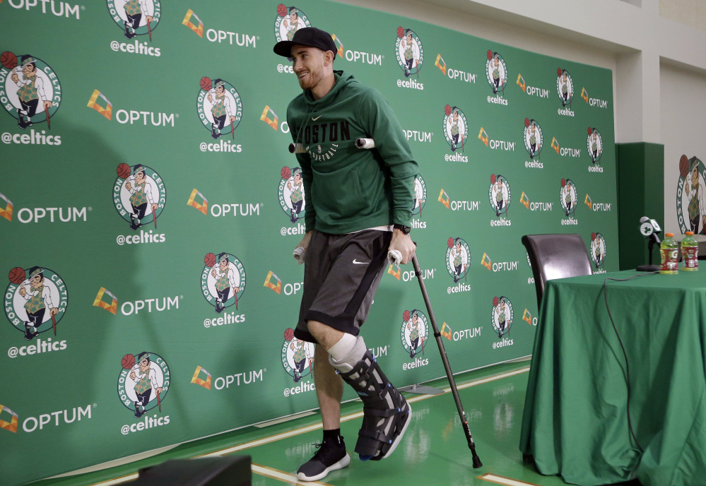 Boston's Gordon Hayward uses crutches as he steps away from a podium after taking questions from members of the media at a news conference Thursday at the team's' training facility in Waltham, Massachusetts. Hayward, who broke his ankle in his Celtics' debut at Cleveland on Oct. 17, says he knows he will not play again this season, after needing surgery to repair the injury.