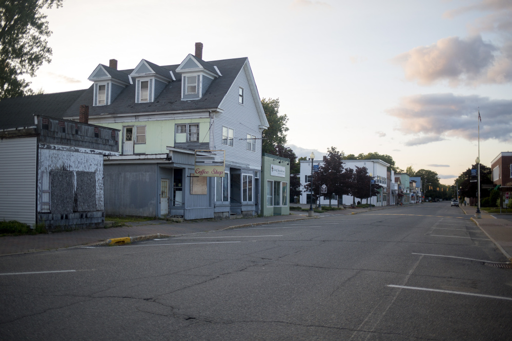 Downtown Millinocket on a Wednesday evening. The town has suffered economically since the mill closures, but there are a few new businesses popping up in a few of the shuttered stores in downtown since the designating of the national monument. (Photo by Brianna Soukup/Maine Sunday Telegram)