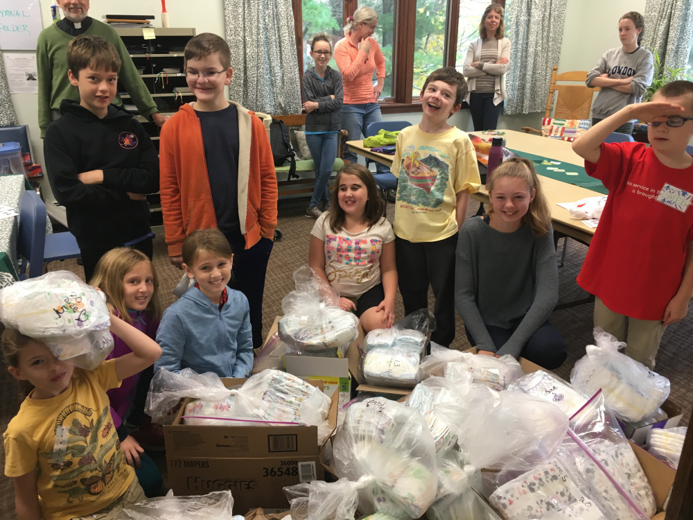 A group of volunteers from St. Mark's Church in Waterville, gathered Oct. 15 to pack diapers for the Essentials Closet at the Waterville United Church of Christ. Front, from left, are Penny Graham, Sarah and Catherine Mansir, Brooke Pullen, Gus Graham, Elizabeth Hardy, Caleb Knock. Second row, from left, are Colby Hardy and Jonathan Eccher-Mullally. Back row, from left, are John Balicki, rector of St. Mark's; Sally Stokes, Bess Stokes, Angela Hardy and Maggie Stokes.