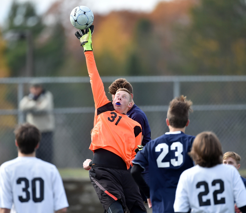 Winslow goalie Jake Lapierre (31) makes a save in the first half off a Yarmouth corner kick during the Class B state championship game last season at Hampden Academy.