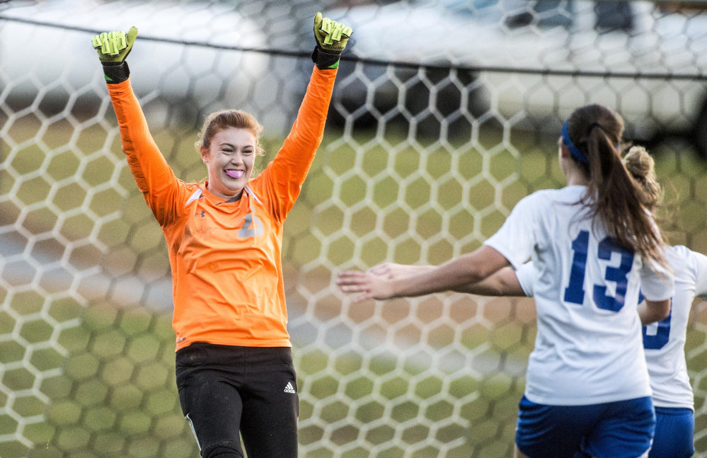 Madison goalie Lauren Hay raises her hands in celebration after making two key saves in a shootout against Traip in a Class C girls south semifinals game in Madison on Oct. 27.