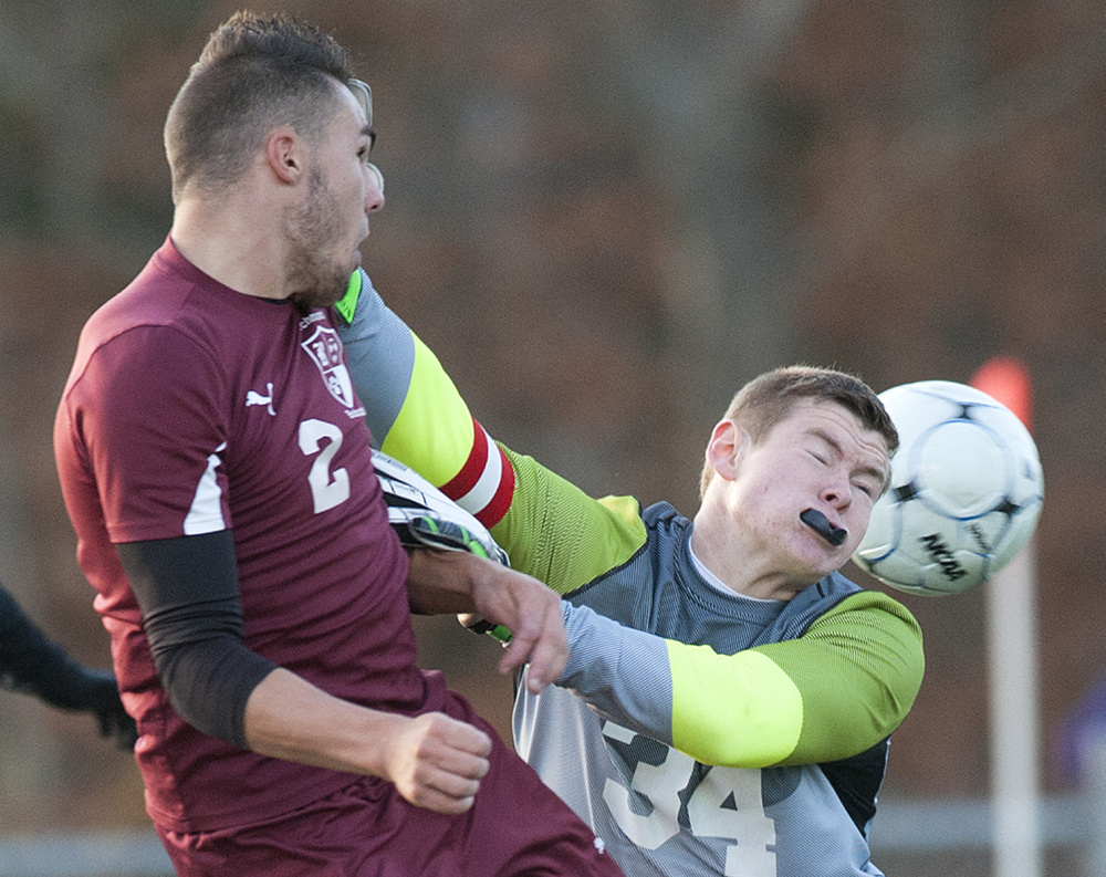 Richmond's Ben Gardner, left, collides with Bangor Christian goalie Jeremiah McNally durig the Class D state championship game Saturday at Hampden Academy.