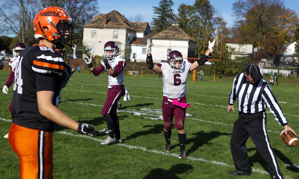 Maine Central Institute's Adam Bertrand (6) celebrates after the official says that David Young's catch was inbounds while Winslow's Hunter Campbell shows his disbelief during a Class C North semifinal game Saturday at Poulin Field in Winslow.