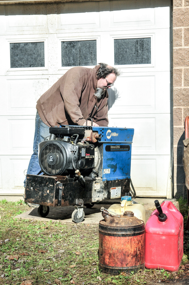 Mike Gorman starts his generator Saturday at his home on Mount Pisgah Road in Wayne.