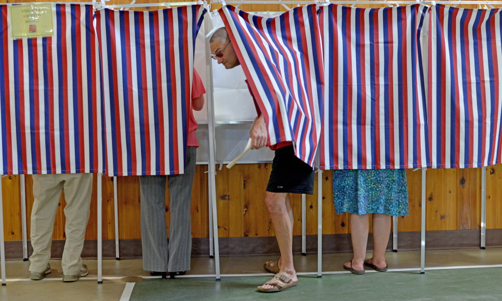 Voters cast their ballots June 30, 2015, in the booths at the Belgrade Community Center.