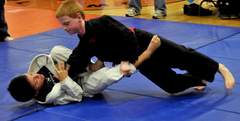 Andrew Harden, top, tries to pin Sam Levesque during the 22nd annual Maine Skirmish Grappling Tournament on Sunday in Winslow.