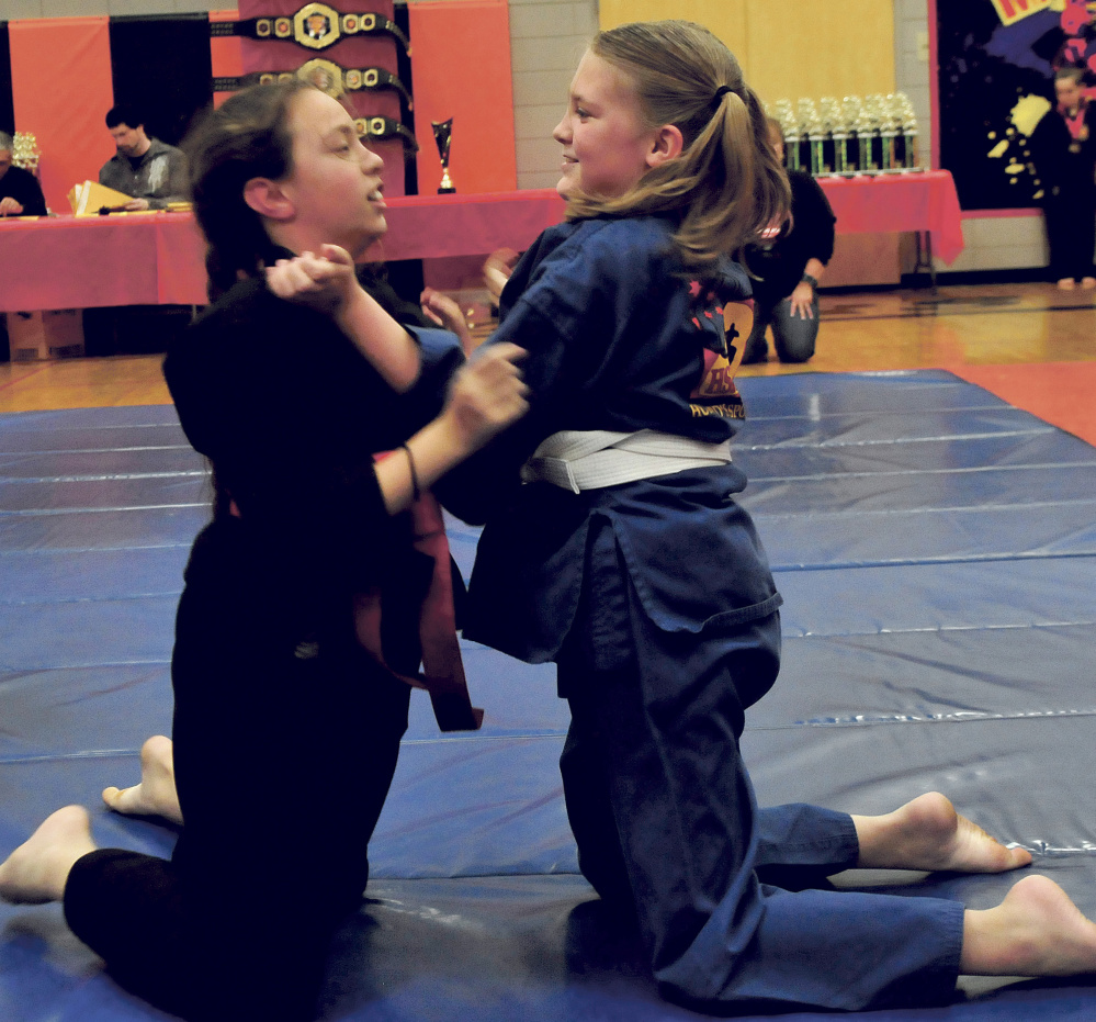 Nawkia Poirier, left, and Carlie Bertrand, both of Freedom, compete during th 22nd annual Maine Skirmish Grappling Tournament on Sunday in Winslow.