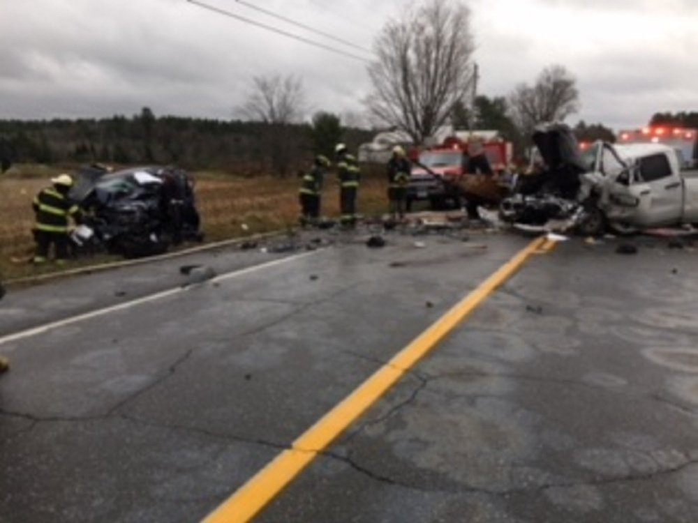 Norridgewock firefighters worked for two hours to extricate the driver of a Jeep Liberty, left, that had been hit head-on by a GMC pickup that crossed the centerline on Route 201A in Norridgewock.