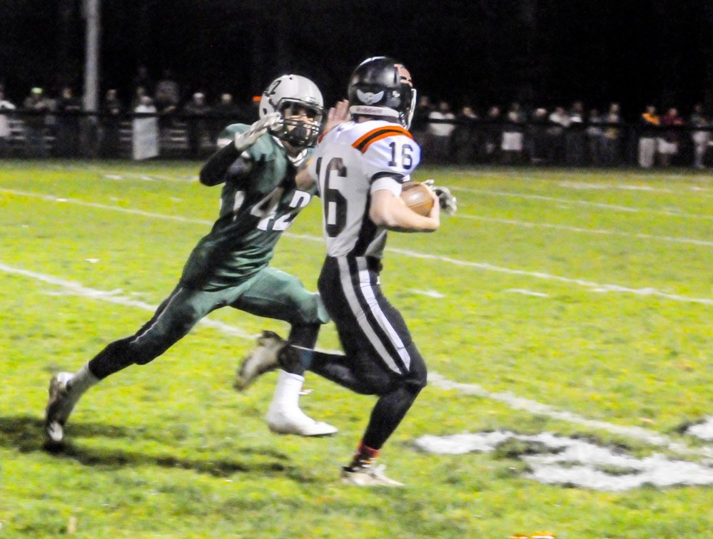 Gardiner running back Collin Foye tries to out-run Leavitt defensive back Caleb Brown during a Class C South semifinal game Friday in Turner.
