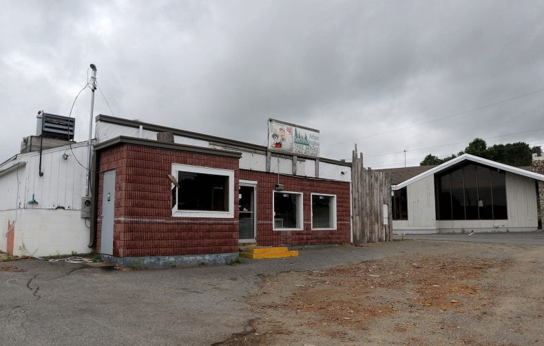 The Weathervane Restaurant and a former car wash and arborists building on Kennedy Memorial Drive sit vacant in August 2015. Marden's Surplus & Salvage owners are proposing to build a strip mall on that property.