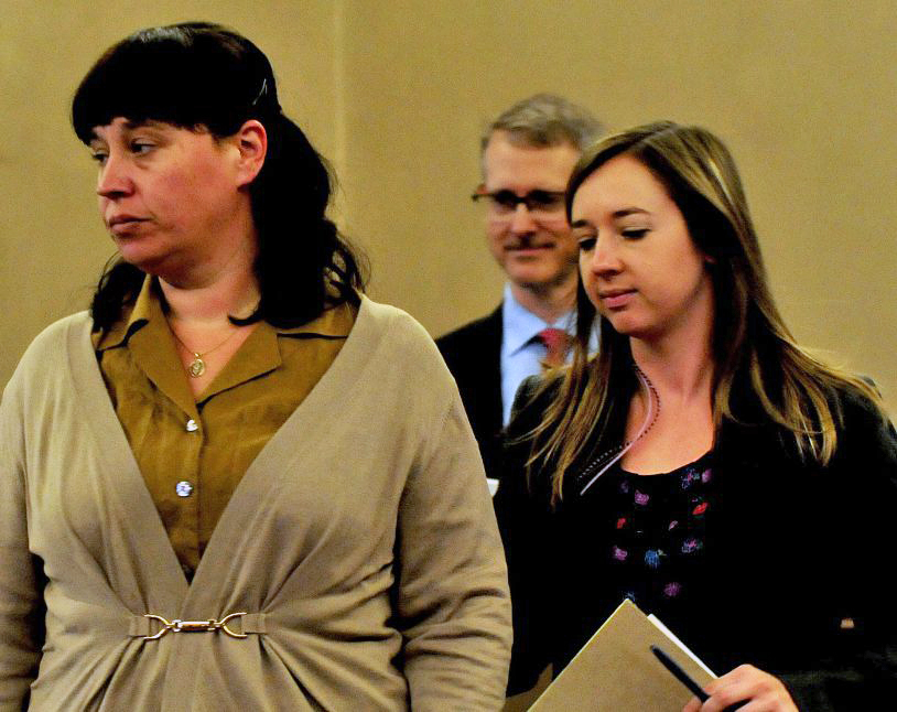 Miranda Hopkins, left, of Troy and her defense attorneys, Christopher MacLean and Laura Shaw, inside Waldo County Superior Court in Belfast for the start of her manslaughter trial in the death of her son last week.