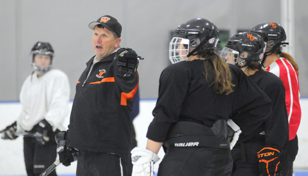First-year Winslow/Gardiner coach Alan Veilleux instructs players during a drill Tuesday night at the Camden National Bank Ice Vault in Hallowell.