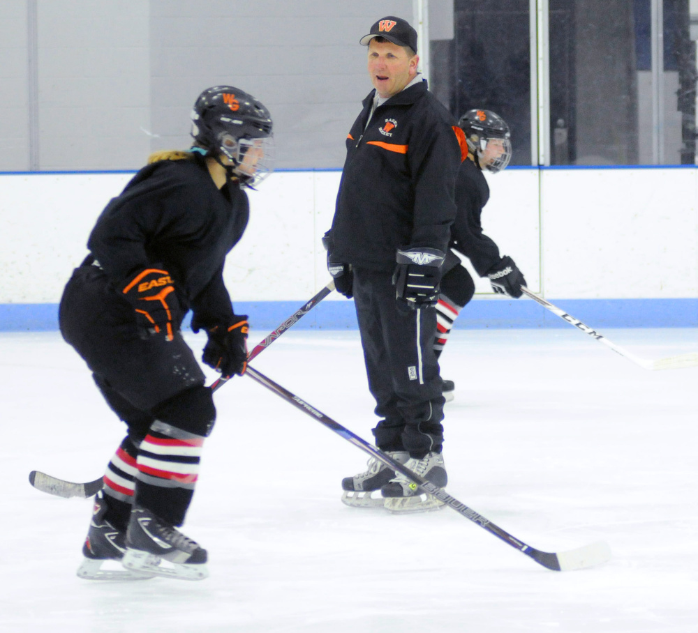 New Winslow/Gardiner girls hockey coach Alan Veilleux instructs players  during a drill Tuesday night at the Camden National Bank Ice Vault in Hallowell.