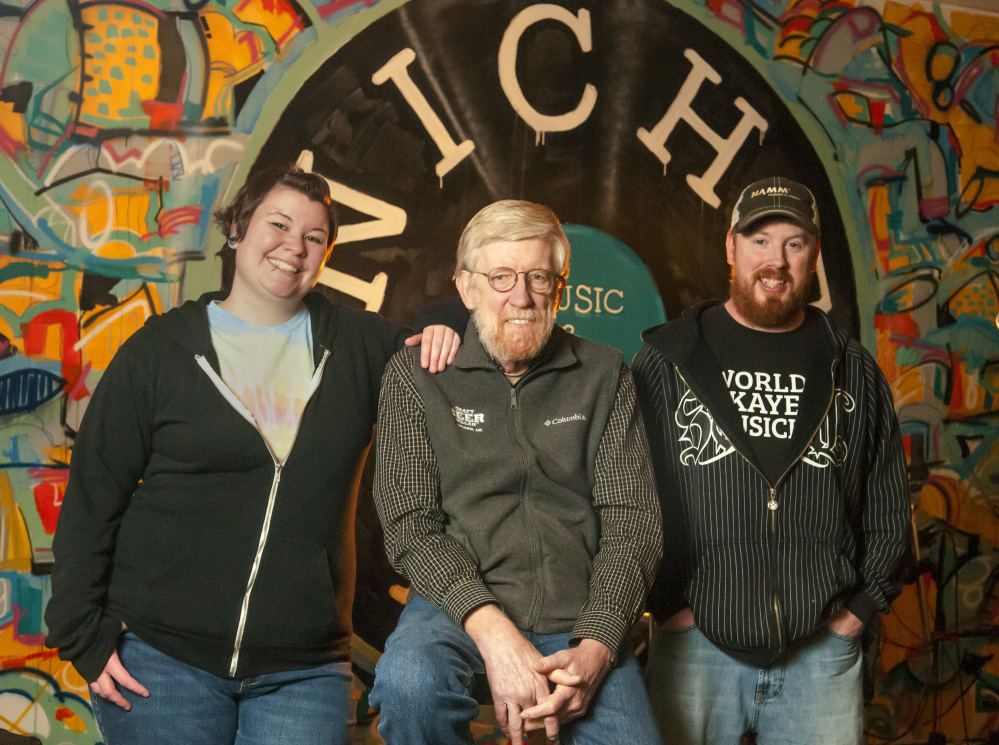 From left, Samantha Robinson, John Callinan and Jason Goucher gather on Tuesday at Niche Inc. in Gardiner. Callinan, who runs the Craft Beer Cellar, and Robinson and Goucher, who run Niche Inc., started their businesses two years ago.