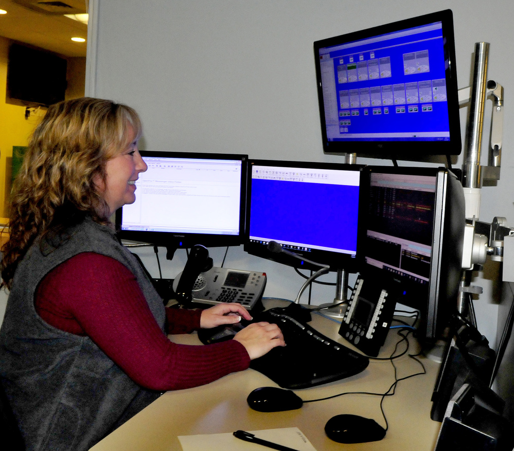 Dispatcher Terri Dessent fields a call Wednesday afternoon at the Waterville Area Communications Center. The Waterville City Council on Wednesday night authorized the city manager to renew the city's police dispatch contracts with area towns at a 3 percent increase.