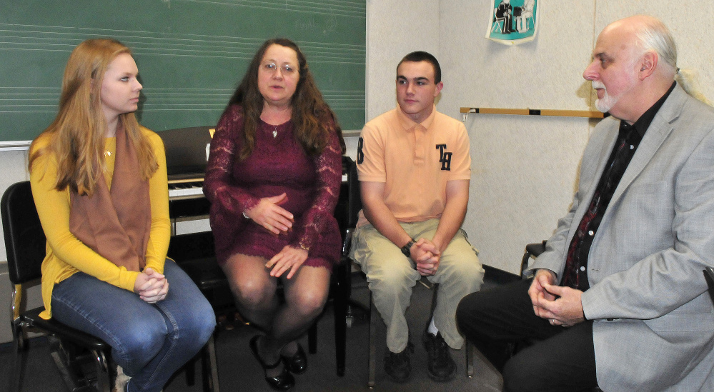 """Messalonskee High School Concert Chorus director Pam Rhein speaks on Thursday with her husband and co-director Kevin and students Julia Cooke and Taylor Doone, who, along with other students, performed and made """"Songs of Darkness and Hope."""" The recording has been nominated for a Grammy Award in the choral category."""