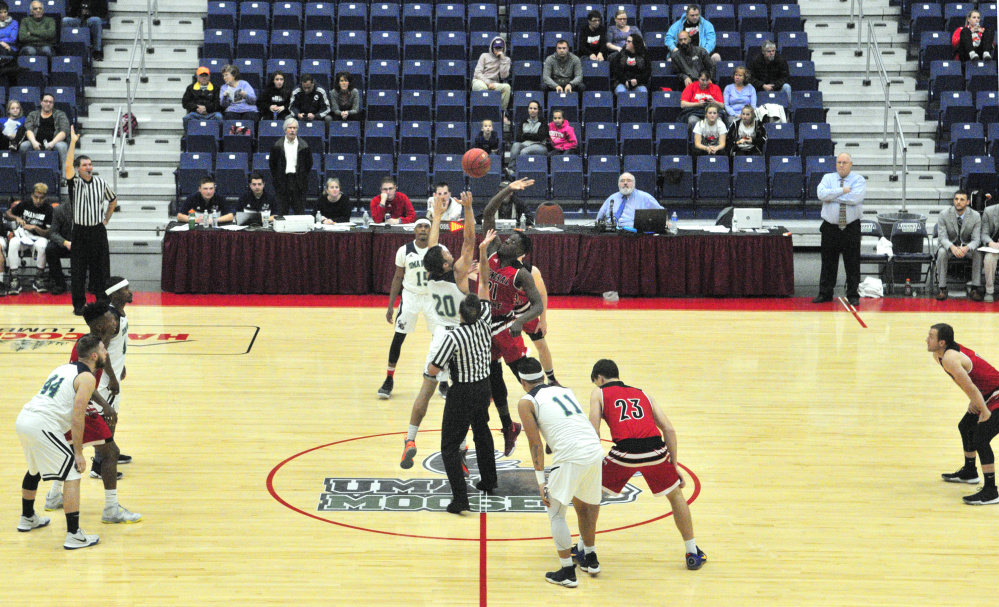University of Maine at Augusta's Justin Simpson-Bragg, of Fairfield, left, and Central Maine Community College's Josh Cherry tip off to start a game on Wednesday at the Augusta Civic Center.