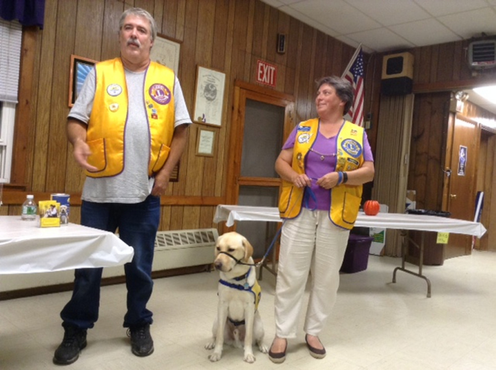 Kittery Lion Scott Mace, left, with Bennix and Kittery Lion President Mary Mace.
