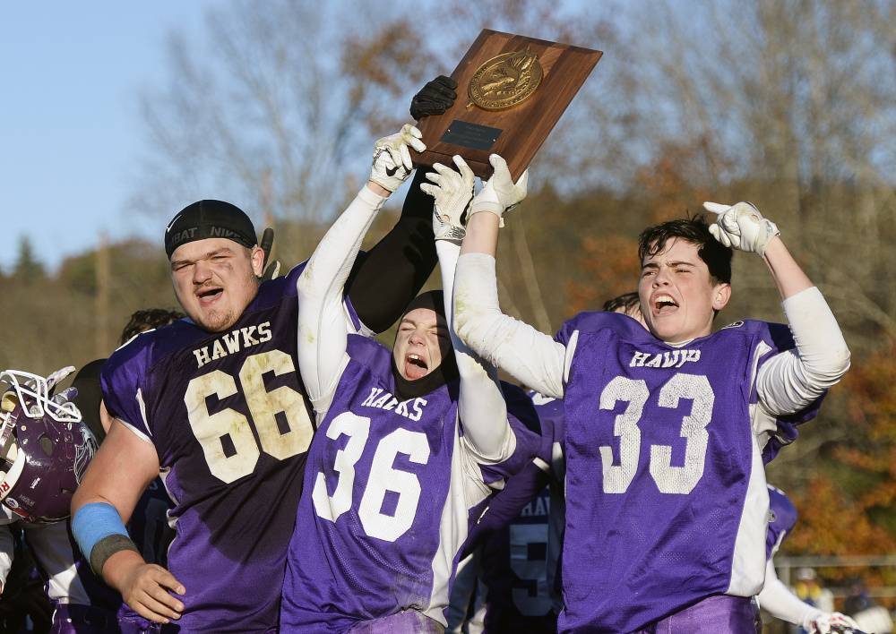 Marshwood players  Seth Aumann, Kyle Glidden and Max Horton celebrate after they won the B South championship Saturday afternoon.