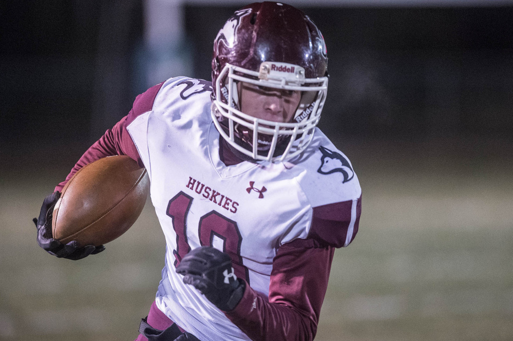 Maine Central Institute's David Young runs for extra yards during the Class C North championship game Saturday night in Bar Harbor.