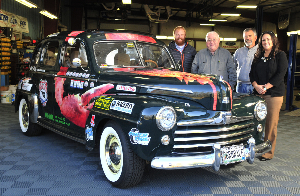 From left, Patrick Wright, Peter Prescott, Ed Chapman and Katie Doherty pose with Prescott's 1948 Ford four-door convertible on Wednesday in Gardiner.