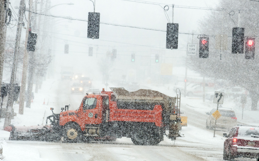 An Augusta snow plow crosses Western Avenue at Sewall Street during a nor'easter on March 14 in Augusta, where city staff are looking for ways to improve snow removal.